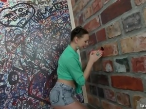 Eye-catching funny hottie wanks and sucks fake cock via glory hole