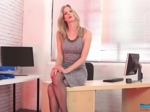 Sexy blondie Leah exposes her really juicy titties in the office