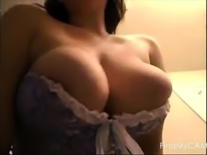 Boobs spill out of corset