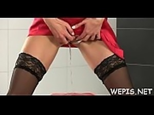 Agile girl is masturbating her juicy pussy and pissing