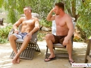 Naughty sexy blond head Cherie Deville gives titjob and rides dick in the pool