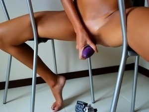 Stunning camgirl has a purple toy driving her slit to orgasm
