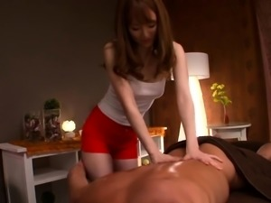 Charming Asian masseuse gets her hairy slit toyed and fucked