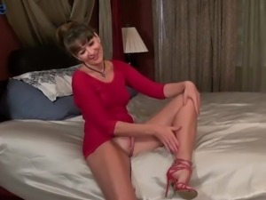 Kinky smiling mature lady is ready to work on her own wet pussy