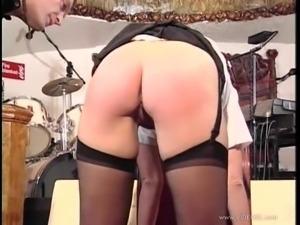 Kinky slut wearing stockings gets her butt spanked hard
