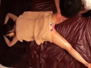 Slender Asian babe has a masseuse taking her pussy to orgasm