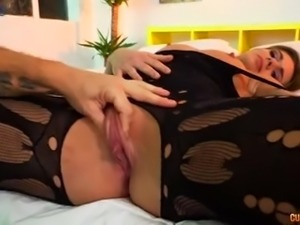 Dressed in black stuff Hungarian beauty Lara West greedily blows dick