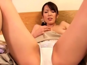 Enticing Oriental milf feeds her hungry pussy a thick cock
