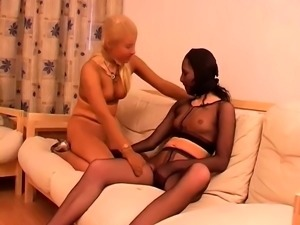 Blonde and brunette babes in nylons enjoy kinky lesbian sex